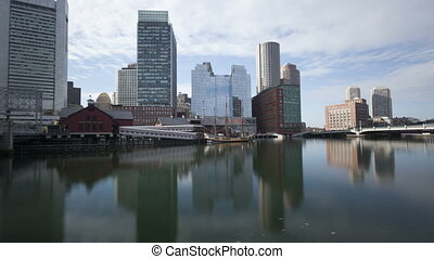 Time lapse tilt shot Boston waterfront with skyscrapers and...