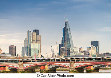 Blackfriars Bridge and London skyline.