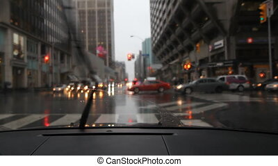 Rainy Bloor and Bay. Toronto. - Driving on Bloor St going...
