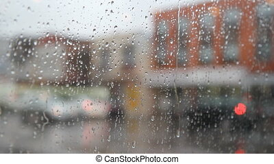 Rainy city. Jacket man walks by. - View of rainy street. Man...