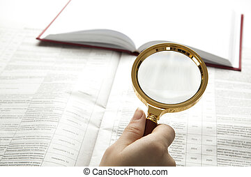 worker examines a magnifying glass text close up