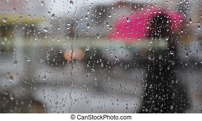 Rainy city umbrellas. - View of rainy street. People with...