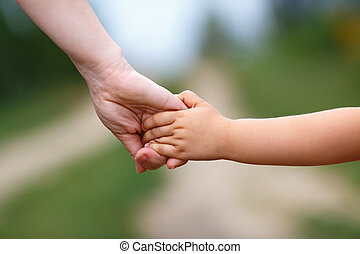 Holding hands - Hands of mother and child. Holding hands....