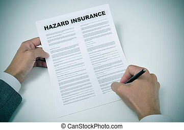 a young man signing a hazard insurance policy