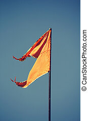 Orange Hindu temple flag in the breeze