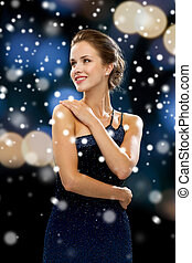 smiling woman in evening dress - people, christmas, holidays...