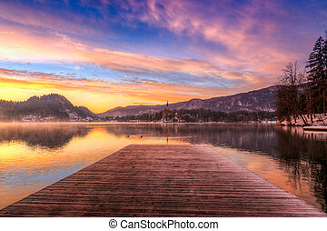 Bled with lake in winter, Slovenia - Amazing sunrise at the...