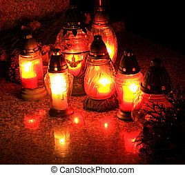 Candles on the cemetery - commemoration of all faithful...