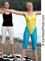 Workout Outdoor - two women has breath exercises after...