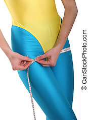 Hips measurment - Woman measures her hips after training