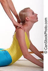 Streching Exercises - Fitness instroctor helps by streching...