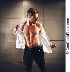 Businessman undresses - A businessman undresses of his...