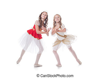 Two adorable ballet dancers, isolated on white background