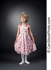 Little dancer posing in pink dress and diadem - Image of...