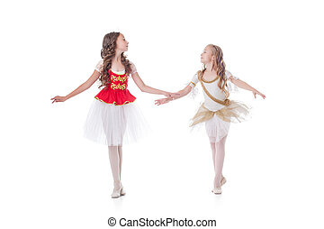 Two cute young ballerinas looking at each other - Cute young...