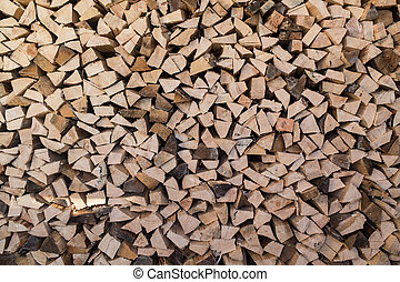 woodpile - chopped firewood for the stove in the woodpile