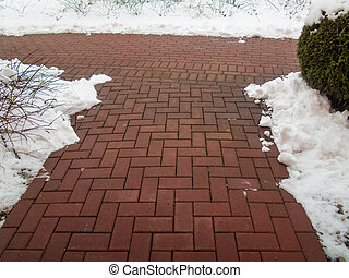 Garden stone path with snow Brick sidewalk - Wintertime...