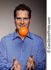 Diet and healthy nutrition Man throwing orange - Diet and...