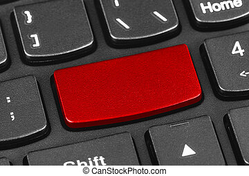 Computer notebook keyboard with blank red key - technology...