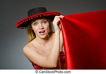 Woman wearing sombrero hat in funny concept