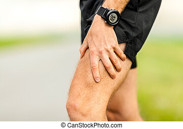 Physical injury, runner muscle pain - Man runner holding...