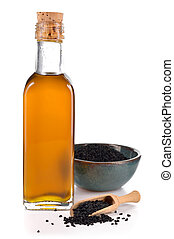 Nigella sativa oil isolated - Nigella sativa oil in a bottle...