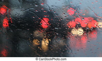 Rainy redlight. - Sitting in parked car with view of traffic...