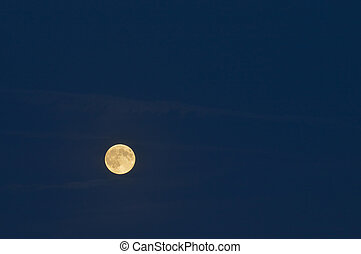 Full moon over dark blue sky Gold full moon Late summer...