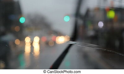 Rainy city intersection - Sitting in parked car with view of...