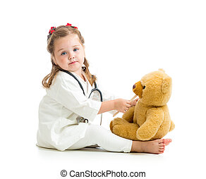 Adorable kid dressed as doctor playing with toy over white