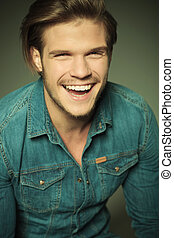happy young fashion man laughing - Close up picture of a...