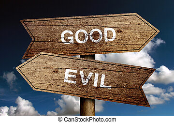 Good Or Evil concept road sign with blue sky background