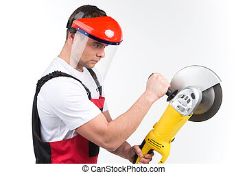 Mechanic with electric tool isolated on white background. side view of man holding circular saw