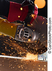 closeup on electric saw and hands of worker. man working...