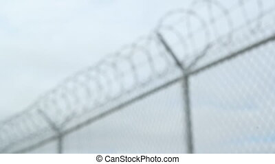 Barbed wire fence. Rack focus. - Barbed wire fence. Rack...