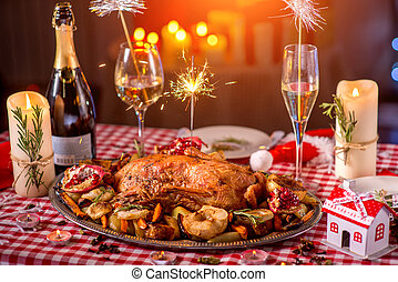 Turkey on CHristmas decorated table - Turkey garnished with...