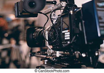 Video camera - Large professional black video camera filming...