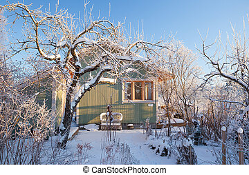Summer cabin at winter Clear blu sky
