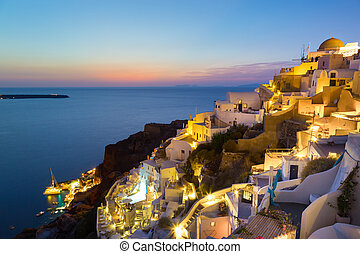 Oia village on Santorini in sunset, Greece. - World famous...