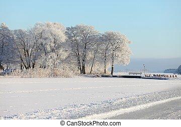 Frozen lake - Winter landscape with frozen lake