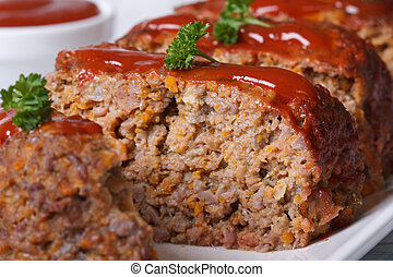 sliced meat loaf with tomato sauce macro, horizontal -...