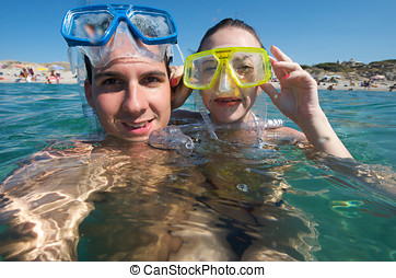 Lovely couple enjoying snorkeling during their vacation