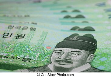 Korean Won - A close-up of several Korean 10,000 Won...