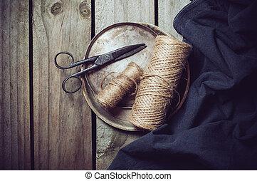 Vintage still life, old scissors, cupronickel trays, dark...