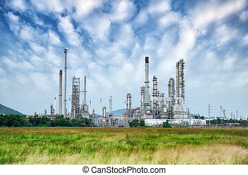 Oil refinery along daytime with blue sky