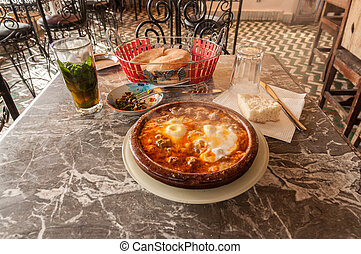Tajine in a traditional moroccan restaurant Fez, Morocco,...