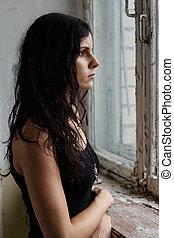 Beautiful girl on a battlefield - War, conflict. Female...