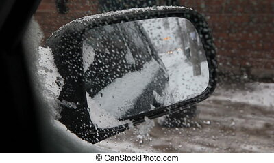 Winter mirror. - View of sidewalk and traffic in side mirror...