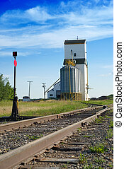 Grain Elevator - A large grain elevator in the prairies is...