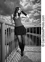 WB portrait on floodgate - Nice redhair lady posing in...